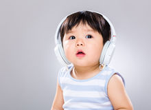 Baby boy wearing headphone Stock Images