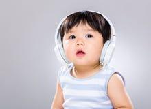 Baby boy wearing headphone Stock Images