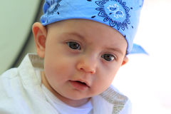 Baby boy wearing a headscarf Royalty Free Stock Photo