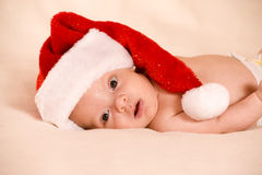 Baby boy wearing a Santa hat Royalty Free Stock Photo