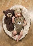 Baby Boy Wearing A Teddy Bear Hat and Romper Royalty Free Stock Photography