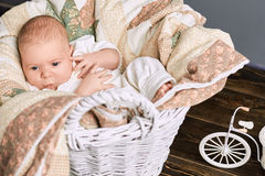 Baby boy whistling. Basket, blanket and infant. Music in the genes Stock Photo