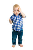 Baby boy on a white background. headache Royalty Free Stock Image