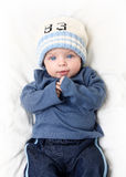 Baby boy on white blanket Royalty Free Stock Photos