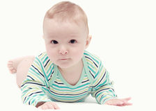 Baby boy on white blanket Stock Images