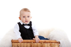Baby boy in a white shirt, bow-tie and vest Royalty Free Stock Photos