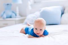 Baby boy in white sunny bedroom Royalty Free Stock Photo