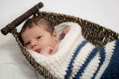 Baby boy in a wicker basket Royalty Free Stock Photo