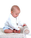 Baby Boy on Wicker Bench Royalty Free Stock Photography