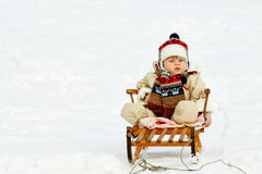 Baby boy winter game Stock Images