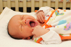 Baby boy yawning Royalty Free Stock Images