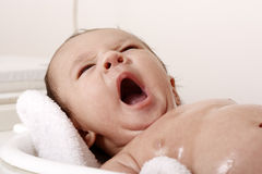 Baby boy yawning and bathing Stock Photography