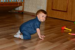 Baby boy 1 year old house royalty free stock image
