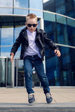 Baby boy 7 - 8 years in a black leather jacket dancing Stock Photos