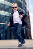 Baby boy 7 - 8 years in a black leather jacket dancing Royalty Free Stock Photo