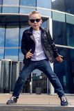 Baby boy 7 - 8 years in a black leather jacket dancing Stock Photography