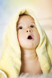 Baby boy with yellow blanket looking up. Royalty Free Stock Photography