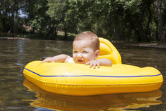 Baby boy with yellow rubber ring Royalty Free Stock Photo