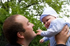 Baby boy and young man. Cute baby boy and young man, portrait outdoors Royalty Free Stock Photos