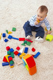 Baby boys building creative play dice. Royalty Free Stock Photo