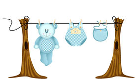 Baby boys clothing with teddy bear on clothesline Stock Image