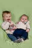 Baby Boys in Winter Clothes. A portrait of two baby boys (cousins) in winter clothes Royalty Free Stock Images