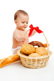 Baby and bread Stock Images