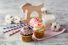 Baby breakfast with milk and cupcakes Royalty Free Stock Photography