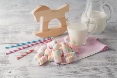 Baby breakfast with milk and cupcakes Stock Images