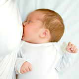 Baby is breast feeding closeup Royalty Free Stock Photos