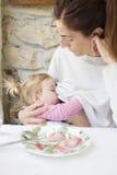 Baby breastfeeding mother in restaurant Royalty Free Stock Photos