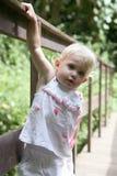 Baby on a bridge Stock Photo
