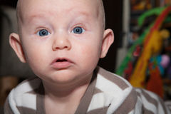 Baby with Bright Blue Eyes Royalty Free Stock Images
