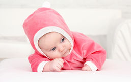 Baby in is bright-pink overalls Royalty Free Stock Photos