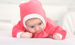 Baby in is bright-pink overalls Royalty Free Stock Photography