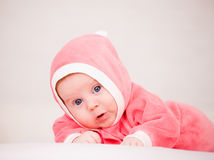 Baby in is bright-pink overalls Royalty Free Stock Images
