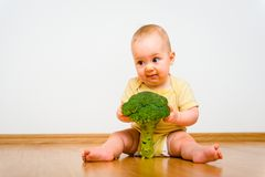 Baby with broccoli - I do not like it Royalty Free Stock Photos