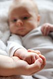 Baby and Brother Lovingly Holding Little Hands Stock Images
