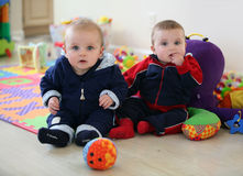 Baby brothers playing Stock Images