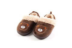 Baby brown slippers. Isolated on white background Royalty Free Stock Images