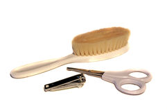 Baby brush, scissors and nail clippers Stock Image