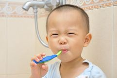 Baby brush teeth Stock Photography
