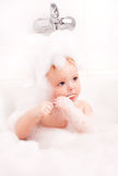 Baby brushing teeth Stock Photo