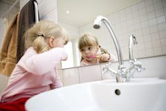 Baby Brushing teeth Royalty Free Stock Images