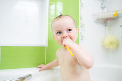 Baby brushing teeth in bathroom Royalty Free Stock Photos