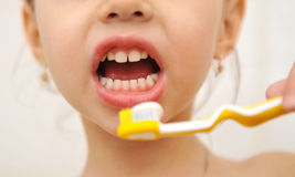 Baby brushing teeth Stock Image