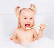 Baby brushing teeth Royalty Free Stock Photography
