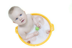 Baby in bubble bath Stock Images