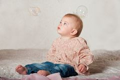 Baby with bubbles Stock Images