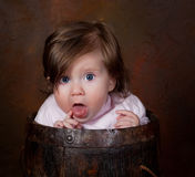Baby in a bucket Stock Photo